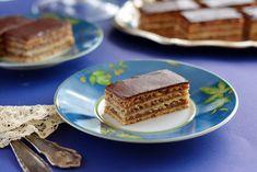 Ismét egy klasszikus: baracklekvár és dió, könnyű tészta, és az ezek édességét ellensúlyozó étcsokiréteg. Zserbó!
