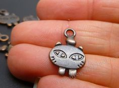 Hey, I found this really awesome Etsy listing at https://www.etsy.com/listing/198664213/10-cat-charms-in-antique-copper-metal