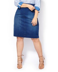 """Slip into flawless style with this timeless plus-size jean skirt! Made with an extra stretchy cotton blend denim fabric, it has a comfortable pull-on waistband, stylish wash and flattering fit. Team it with your favourite fashion tops! Length: 26"""""""