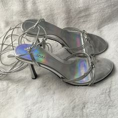 """NEW! Cute Silver Wrap Sandals NEW! Cute Silver Wrap Sandals. They wrap up leg and tie. Heel is about 3-1/2"""". Club Zone Shoes Sandals"""