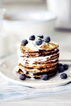 blueberry pancakes - I love this kind of food photography : the light, the contrast, the pops of color, the shallow depth of field.