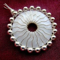 Fortune's Wheel pendant tutorial - nice way to capture a donut. #wire #tutorial