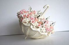 Top your wedding cake with a gorgeous custom-made umbrella filled with beautiful flowers to match your theme.    Buy it on  Etsy .