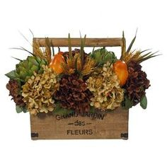 Silk floral arrangement with artichoke and pear accents in a wood basket with a French typography motif. Product: Faux floral arrangementConstruction Material: Silk, plastic and woodColor: MultiFeatures: For indoor use onlyDimensions: 13 H x 16 W x 12 D