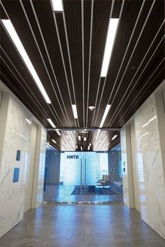 This installation gallery from Armstrong Ceiling Solutions – Commercial showcases applications to help inspire your next project. View the gallery Modular Office, Linear Lighting, Ceiling Design, Interior Lighting, Olympia, Architecture Design, Commercial, Ceiling Lights, Photo And Video