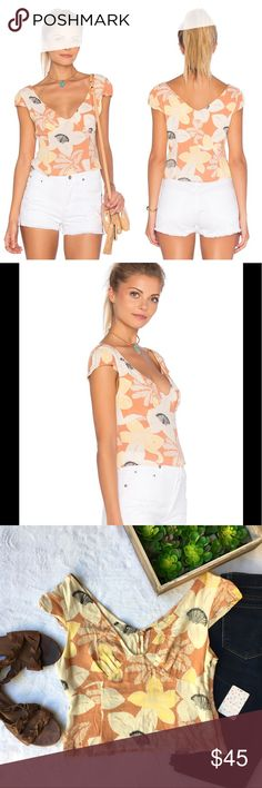 Into the Groove floral cap sleeve cropped top Lovely floral print cap sleeve crop top from Free People. V-neck front and back, crepe fabric with fitted bust. Perfect for summer with shorts and sandals! Zip closure. NWT. Size 8 Free People Tops Crop Tops