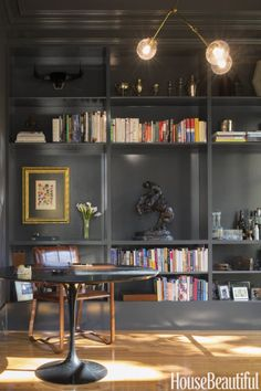 "Black built-ins are popping up everywhere lately, like in this study by Carmel Greer. ""This gray-black reminds me of shadows — for me, that's a good thing,"" she says. ""With the gold overhead light and leather chair, it's tailored and masculine, not cave-like."" Make it yours: Clark+Kensington Black Chiffon N-C15"