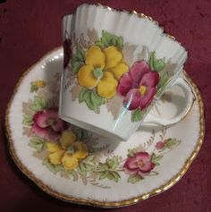love the pansies and the scalloped rim of cup