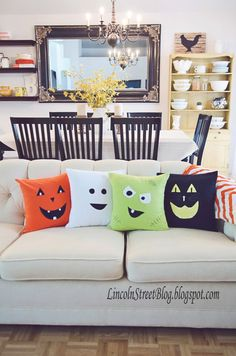 """Halloween Face Pillows: Charm guests with these comfortable throw pillows made from just a few cuts of fabric.These easy to make DIY Halloween themed throw pillows will make your house """"boo""""tiful. Find more easy DIY Halloween decorations here. Spooky Halloween, Halloween Projects, Holidays Halloween, Happy Halloween, Halloween Party, Outdoor Halloween, Vintage Halloween, Halloween Mural, Halloween Sewing"""