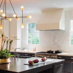 Dk gray/black cabinetry and countertops, lighting in kitchen