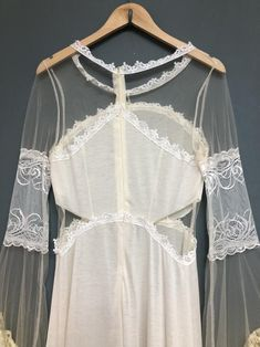 Jersey Knit body cut out with net and lace fill , centre back neck zip Cream and Neutral Tiered Skirt 17 inches pit to pit (flat) 56 inches centre back neck to hem Excellent Condition 1980s Style Wedding Dresses, Wedding Dresses Size 14, Slow Fashion, Vintage Inspired, Centre, Fill, Neutral, Cream, Lace
