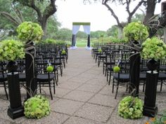 Lovely green and black outdoor wedding ceremony.