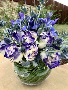 This exotic flower arrangement using purple roses, iris and thistle is a form arrangement. It's form is a circle. Purple Roses, Exotic Flowers, Iris, Flower Arrangements, Spring Summer, Plants, Floral Arrangements, Purple Rose, Plant