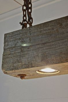 Rustic Modern hanging reclaimed wood beam light fixture with rusted chain
