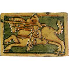 """Antique Mercer Moravian Tile c.1920 Arts & Crafts Knight on Horse. This handsome Arts & Crafts period tile was made by the Moravian Tile & Pottery Works in Doylestown, Pa. This tile is made of a red earthenware and bears no makers marks. This was made in the earlier years of the company. It measures approximately 5"""" x 7.5"""" x .5"""" thick."""