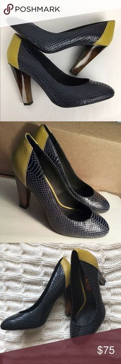 7 for all mankind snakeskin heels 7 FAM heels in mustard yellow and deep navy blue (almost black) these are in good condition. Scuff to inner heel on right shoe as shown. Pair with some skinny jeans for a stellar look! 7 For All Mankind Shoes Heels