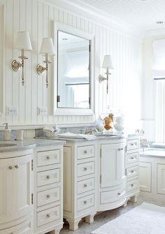 I really like these cabinets.  They have a different shape, and that furniture-like quality.  could do a round vessel sink, and faucet coming out of the wall above instead of the counter