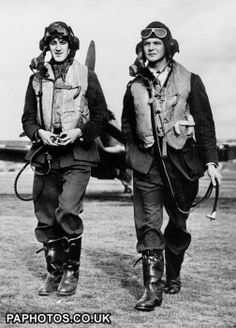 """The Battle of Britain. Two Royal Air Force pilots from Fighter Command walking from an aircraft during the Second World War. c1940.   Agatha Christie's character Jerry Burton was recovering from a """"flying accident."""""""