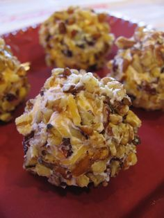 Pecan Crusted Cranberry Cheese Balls / Deen Brothers-  8 oz shredded cheddar cheese,  3 Tb cream cheese, softened ,  3 Tb dried cranberries ,  2/3 c finely chopped pecans,  In a bowl, mix the cheddar, cream cheese & cranberries together. Form  small balls & roll in pecans. Serve at room temperature. Makes 30.