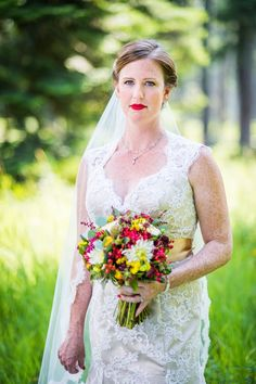 This bride's red lip is EVERYTHING.  #brideside #realwedding #wedding #beauty #redlips #lipstick #beauty #makeup  Vintage lace and wildflowers completed this Montana wedding | Brideside