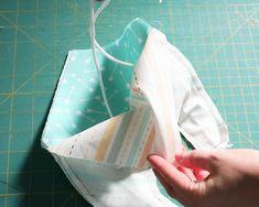 Baby Drool Bibs With FREE Pattern Sewing Patterns Free, Sewing Tutorials, Free Pattern, Crib Sheet Tutorial, Drool Bibs, Fabric Scissors, Macrame Cord, Pom Pom Trim, Baby Sewing
