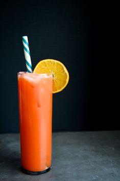 The Retox/Detox Cocktail - Ginger, Carrot Juice, Orange Juice, Lime Juice, Agave or Honey, Tequila, Orange Slice Garnish.