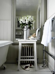 Love the big mirror, and the flowers & such that can cover up the brutal image of a 40-something getting out of the awesome tub:)