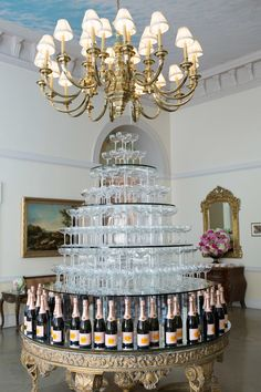 Grand Champagne Glass Tower | Photography: Brett Matthews Photography. Read More: http://www.insideweddings.com/weddings/regal-outdoor-ceremony-ballroom-reception-at-oheka-castle-in-ny/821/