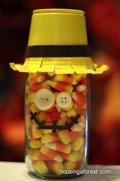 This candy corn scarecrow is so cute!