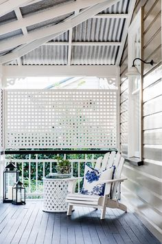 After 14 years of well thought out interior and exterior renovations, this old timber worker's cottage in Brisbane has been transformed into a luxurious yet low-maintenance home to last the ages. Porches, Fresco, Front Verandah, Front Deck, Front Porch, Queenslander House, Lattice Screen, Low Maintenance Garden, Australian Homes