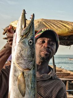 Fisherman with his catch at Bakau fish market Environmental Justice, International Development, Documentary Photography, Documentaries, Boat, Fish, Dinghy, Pisces, Boats