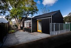 """Designed by David Weir Architects, """"The Exploding! Shed House"""" is a successful experiment in small footprint living for modern Perth. Built in the backyard of a sub-divided bungalow property, the dwelling has been designed to fulfil the home owners simple brief – a small, affordable home with a yard and a 'messy space' for a studio."""