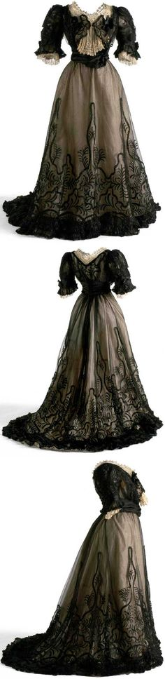 """Evening dress, ca. 1905-06. The boned bodice, which has middle layer of silk gauze & top layer of black tulle, made to look like jacket, with lace as """"bow tie."""" Skirt is black tulle over ecru silk, with chiffon ruffles at hem and black embroidery in plant motifs. Museo del Traje, Madrid"""