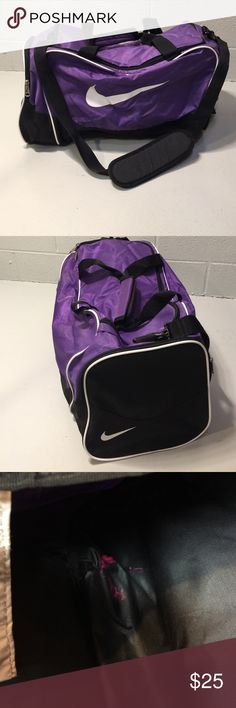 Purple Nike Duffel Bag Functionally in excellent condition. There is a tiny bit of nail polish on the inside corner and a name written in the Velcro handle. Neither are noticeable. Nike Bags