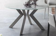 Tavolo design rotondo allungabile con piano in vetro e basamento in metallo