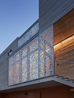 More than ornament, the screens protect double height windows from hurricane force winds.