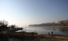 Two men fish on the banks of the Danube river near the Bulgarian town of Vidin.