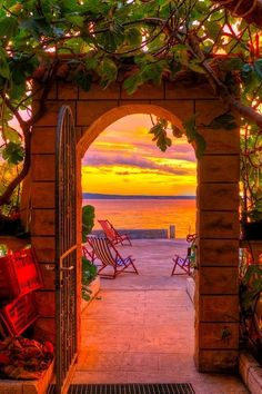 Sunset through a doorway in Santorni, Greece