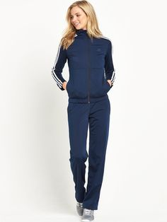 adidasBack 2 Basics Tracksuit Keeping you covered to and from the gym, or keeping you warm in between laps on the track - this Back 2 Basics tracksuit by adidas is an essential addition to your workout-ready pieces. The dark blue hue is complemented by an iconic 3 Stripe motif down each sleeve, while the adjustable hems and full zip front allow you to control the coverage for a personalised feel.Layer it over your training tights and tee when you're ready to workout. Swapping for an Or...