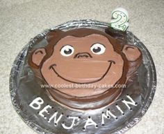 Homemade  Curious George Birthday Cake - great how to - make eyes using the outline of a ketchup lid and pupils are the outline of a soda pop lid.