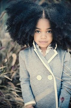 Her hair is amazing and she's just adorable!