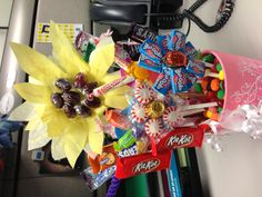 Fun and inexpensive flower bouquet I made for some friends at work.  I was inspired by a picture of a candy sunflower. This would be a great idea for teacher appreciation week