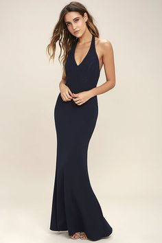 Work your magic in the Love Potion Navy Blue Lace Halter Maxi Dress! A gorgeous lace overlay shapes a plunging halter neckline with double covered button closure and princess seams. Fitted bodice gives way to a stretchy, mermaid maxi skirt. Hidden back zipper and clasp.