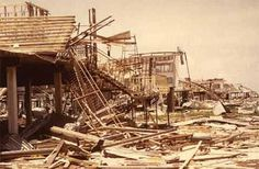 A line of destroyed houses, timber, corrugated iron and debris resulting from Cyclone Tracy. Albert A. Dixon Collection.