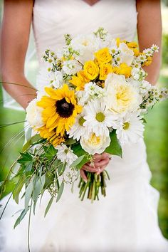 The rustic bouquet is purposely imperfect. Choose an arrangement that looks like you could've plucked it ri...