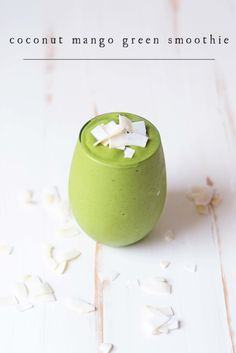 Coconut Mango Green Smoothie // This green smoothie is the perfect balance of creamy coconut and tropical mango. Top with toasted coconut chips and you have a breakfast (or snack) bursting with flavor and great texture.