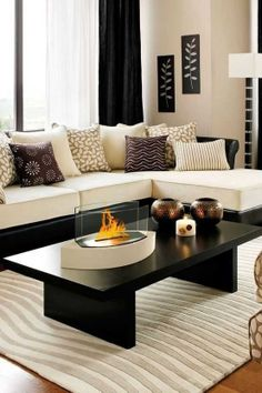 Beautiful living room - love the accent pillows and table top fire place
