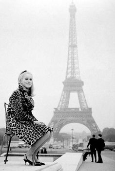 2 of the best examples of French architecture: The Eifel Tower and Catherine Deneuve