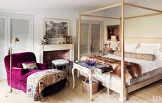 Isabel Lopez-Quesada's home in Architectural Digest. Love the bed & the color of the chair.