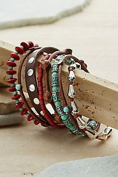 Cheyenne Bracelets Chic meets Southwest in this set of eight handcrafted bracelets, rustically trend-right with studded leather, turquoise-look stones, faceted beads and charm